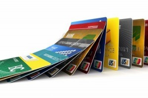 10286298-fake-credit-cards-in-a-row-falling--credit-card-debt-concept